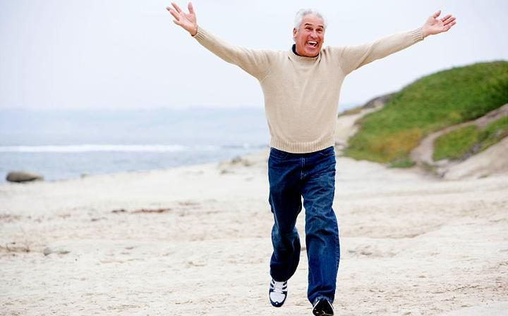retirement-options-older-man-running-on-beach